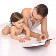 Father and daughter reading a book — Stock Photo