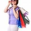 Woman is glasses with bags — Stock Photo