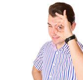 Man looking through a hand — Stok fotoğraf