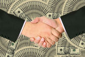 Business transaction is backed by a handshake — Stock Photo
