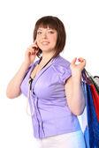 Ragazza con sacchi parla cellulare — Foto Stock