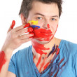 Guy rubs his face paint — Stock Photo