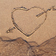 Picture of the heart with an arrow on line of tide — Stock Photo