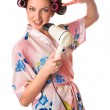 Woman sings karaoke on hair dryer — Stock Photo