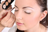 Make-up artists apply makeup model — Stock Photo