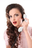 Girl in the style of pin up with phone — Stock Photo