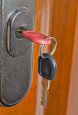 Key in the door lock — Stock Photo