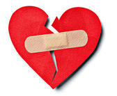 Broken heart love relationship and plaster bandage — Stock Photo