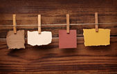 Grunge note paper and clothes peg on wood — Stock Photo