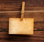 Old photo postcard and clothes peg on wood — Stock Photo