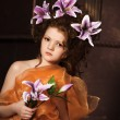 Girl with lilac lilies in her hair — Stock Photo #10361146
