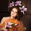 Girl with lilac lilies in her hair — Stock Photo #10361148