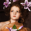 Girl with lilac lilies in her hair — Stock Photo #10361156