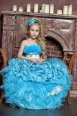 Little girl in a smart blue dress — Stock Photo