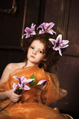 Girl with lilac lilies in her hair — Stok fotoğraf