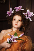 Girl with lilac lilies in her hair — ストック写真