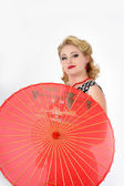 The girl with the Chinese umbrella The photo in style of the 60th years — Stock Photo