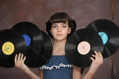The girl with vinyl records — Stock Photo