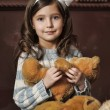 Girl with a bear-cub — Stock Photo