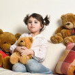 Girl with toy bear cubs — Stock Photo