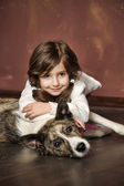 Vintage portrait of a little girl with dog — Stock Photo