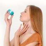 Woman holding moisturizing facial cream — Stock Photo #10600679