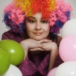 Girl clown and balloons — Stock Photo