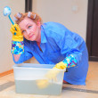 Tired woman cleaning — Stock Photo