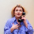 The housewife speaks on the phone — Stock Photo #8226149