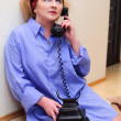 The housewife speaks on the phone — Stock Photo #8226153