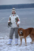 Teen girl walking a large dog in winter — Foto Stock