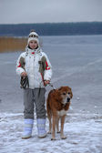 Teen girl walking a large dog in winter — ストック写真