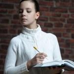 Writing teen girl — Stock Photo
