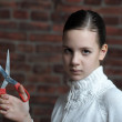Girl with scissors in hand — Stock Photo