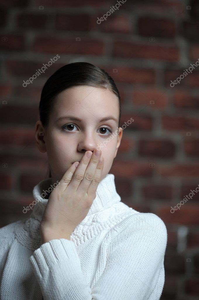 Girl with hand over mouth — Stock Photo #8763704