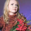 Girl Santa with Poinsettia flower — Stock Photo