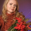 Girl Santa with Poinsettia flower — Stock Photo #8879975