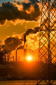 Smoke from factory chimneys at sunset — Stockfoto