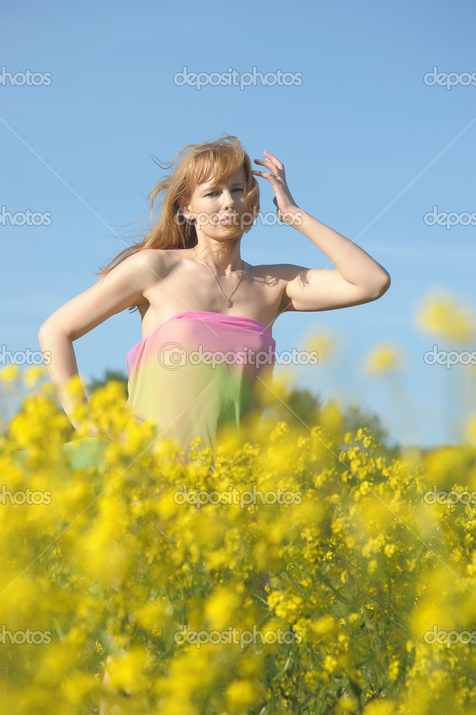 Girl relaxing in field of flowers — Stock Photo #9009603