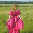 Young woman in an retro dress in the field — 图库照片