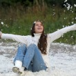 Young beautiful girl filled up by small feathers - Stock Photo