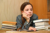Teenager is upset by the big homework — Стоковое фото