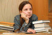Teenager is upset by the big homework — Zdjęcie stockowe