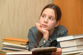 Teenager is upset by the big homework — Stockfoto