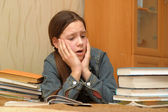 Teenager is upset by the big homework — Stock fotografie