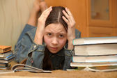 Teenager is upset by the big homework — Stok fotoğraf