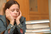 Teenager is upset by the big homework — Stock Photo