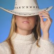 Girl wearing cowboy hat in the studio — Stock Photo #9060863