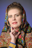 Russian woman in a scarf — Stock Photo