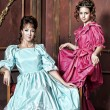 Two ladies in medieval dresses — Stock Photo
